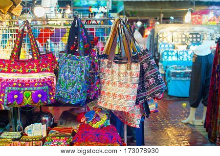 Bags and souvenirs for sell at night market. Chiang Mai Thailand
