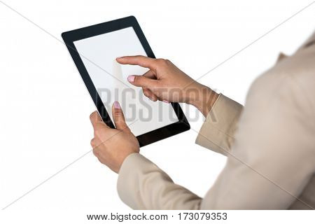 Businesswoman using digital tablet against white background