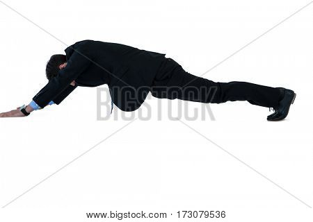 Businessman doing pushup on white background
