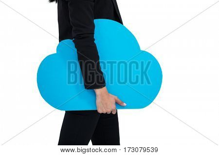Mid-section of businesswoman holding cloud symbol against white background