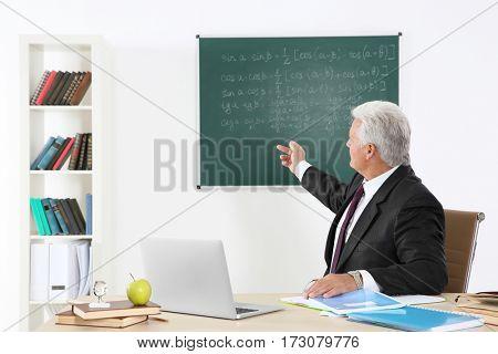 Senior teacher at lesson in classroom