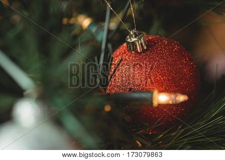 Close-up of christmas bauble hanging on christmas tree during christmas time
