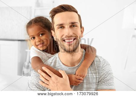 Happy father with cute African American daughter