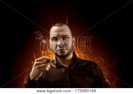 Businessman With Cigar In Hand On Hell Background