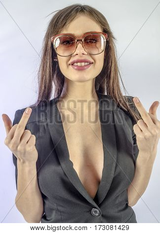 Attractive girl in a black jacket and sunglasses posing coquettishly
