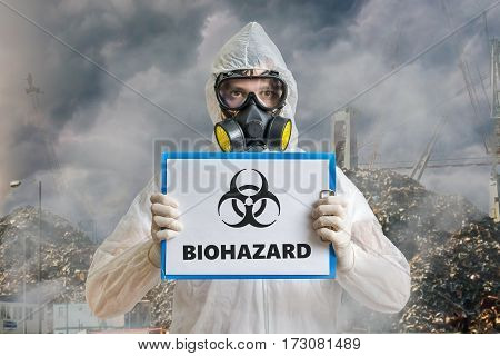 Ecology And Pollution Concept. Man In Coveralls Is Warning Again