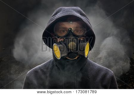 Apocalypse Or Armageddon Concept. Man Is Wearing Gas Mask. A Lot