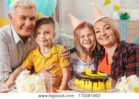 Birthday party. Family sitting at served table
