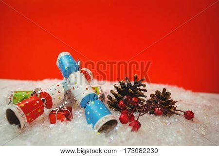 Christmas crackers and christmas decoration on snow during christmas time