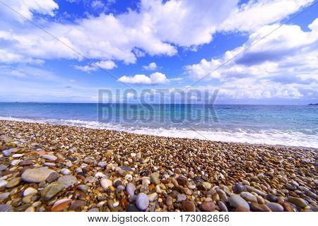 Beautiful sea paradise beach on a background of blue sky with clouds.