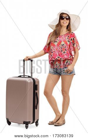 Full length portrait of a female tourist with a suitcase isolated on white background