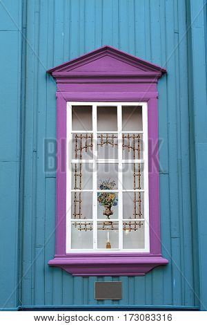 blue wall pink window curtain vase candle holder
