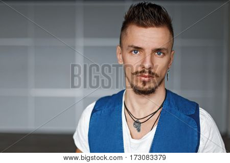 Portrait Of Stylish Man With A Mustache And Beard, Indoors