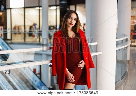Stylish Young Woman In Red Coat At The Mall
