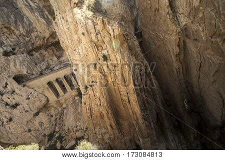 A photo of a train tracks in a ravine