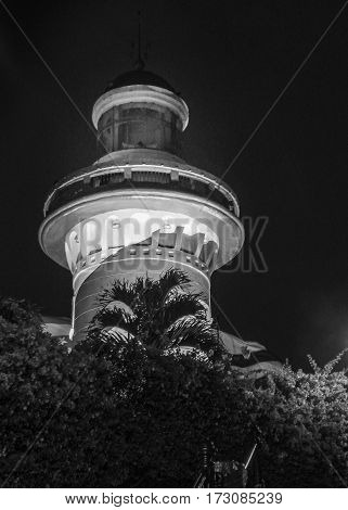 Low angle view night scene of lighthouse at the top of a hill at Cerro Santa Ana in Guayaquil Ecuador.