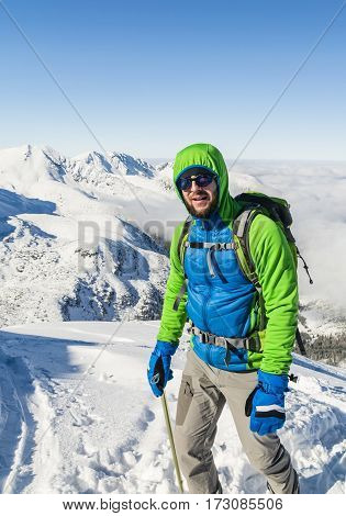 Hiker With Ice Axe Winter In The Mountains.