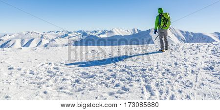 Hiker Watching Winter Mountain Panorama.