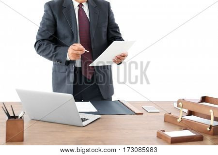 Successful businessman working with documents in office, close up view