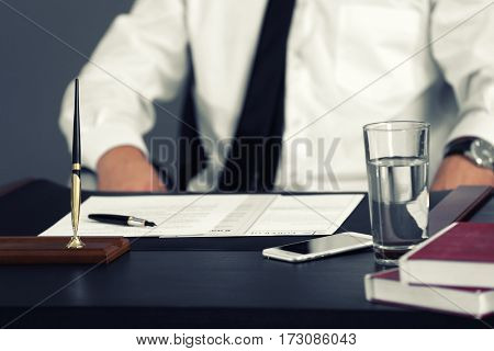 Modern workplace and businessman on background