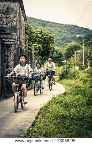 School Kids Riding Bicycles In Hong Kong