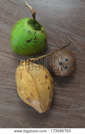 three different coconuts on table top view