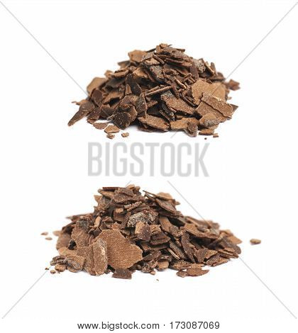 Pile of chocolate flakes isolated over the white background, set of two different foreshortenings