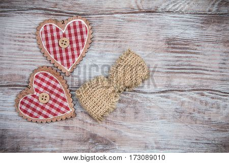 Bow Made Of Burlap And Two Checkered Heart. Valentines Day