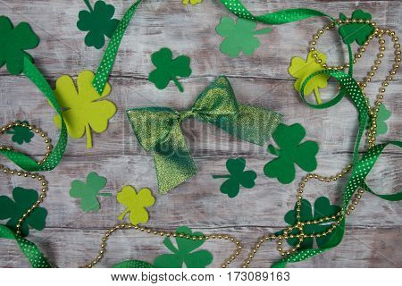 Background Leaf Clover, Ribbons, Green And Gold Beads Shiny Bow