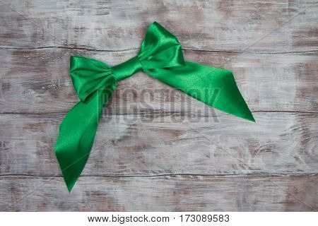 Handmade Big Green Satin Bow On Wooden Table