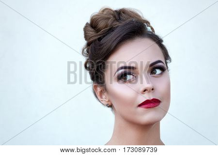Beautiful Girl With Makeup And Coiffure Isolated On A Light Background