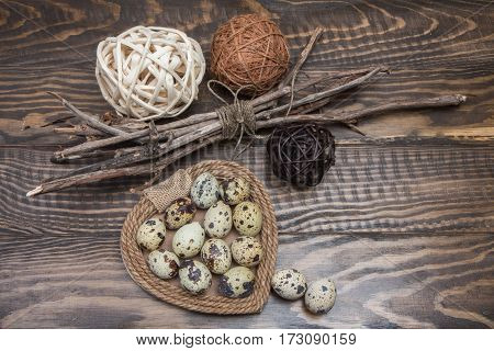 Easter Background With Quail Eggs, Tree Branches And Rattan Balls