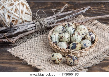 Quail Eggs In Wicker Plate On Napkin Of Burlap. Easter Background