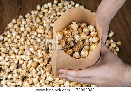 man holding a bag of popcorn close up