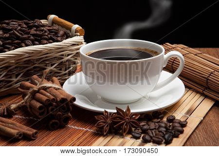cup of coffee spice and roasted beans in the basket