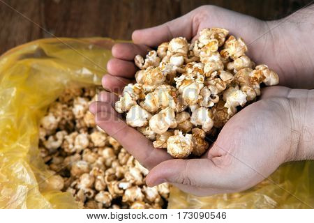 people gaining a bunch of popcorn from the package close up