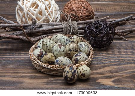 Wicker Dish With Quail Eggs, Twigs Of Wood And Rattan Balls. Easter
