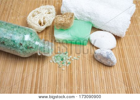 Sea Salt, Green Soap, Stones And Towel. Spa Set On Bamboo Mat