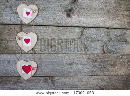 Wooden Photo Frame With Three Hearts On Rustic Background
