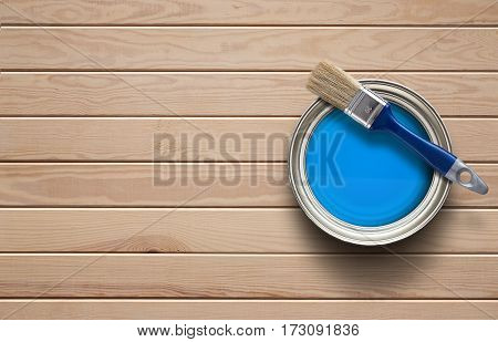 Home improvement paint can on the clear wooden background with copy space