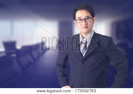 Double Exposure Of Confident Asian Businessman Shaking Hand In Meeting Room.