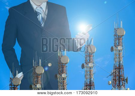 Double exposure of businessman using smart phone to manage his business with telecommunication towers arrange as bar chart on blue sky, communication concept