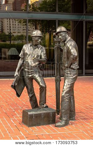 Pittsburgh Pennsylvania USA - July 31 2016: Statue of workmen in a park overlooking the Allegheny River.