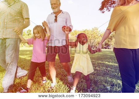 Diverse Family Walking Park Happy Together