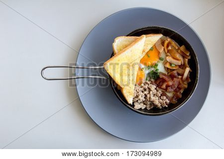 American breakfast contain egg minced pork sausage toast on pan background