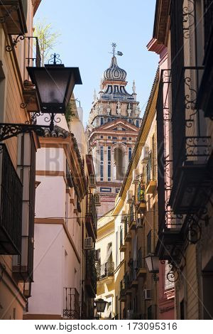 Sevilla (Andalucia Spain): old typical street and historic belfry