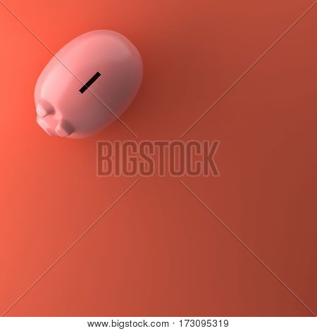 TOP VIEW OF PIGGY BANK ON ORANGE BACKGROUND