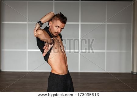 Handsome Man In A Black Clothes With A Naked Torso Dancing
