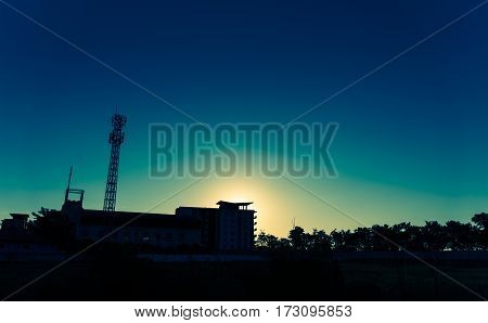 vintage tone silhouette image of Tele-radio tower with blue sky on sunset time.