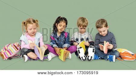 Little Children Reading Books Smiling